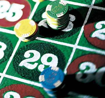 Close-up of roulette chips in the betting area